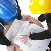 Architects examining construction renderings